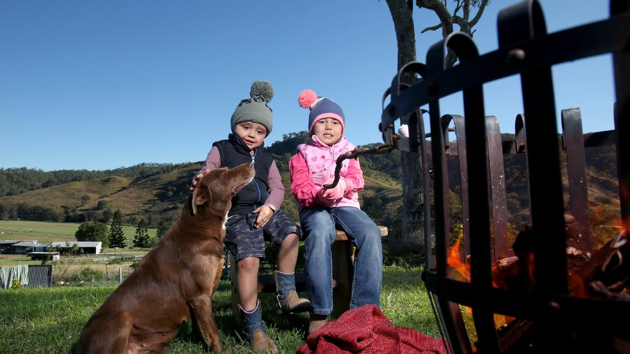 Niko Mckeagg, 3, with sister Naia, 4, cooking mashmallows over the fire and rugged up during the cold westerly weather at Darlington, south of Beaudesert, on Sunday, May 16. Photo: Steve Pohlner