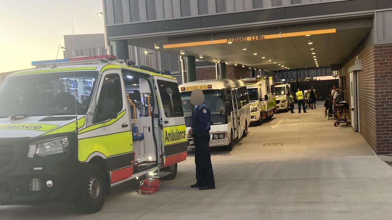 Ambulances transport children injured in the school bus crash to Roma Hospital.