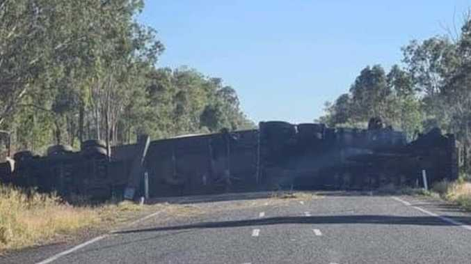 Truck remains on CQ road after rollover