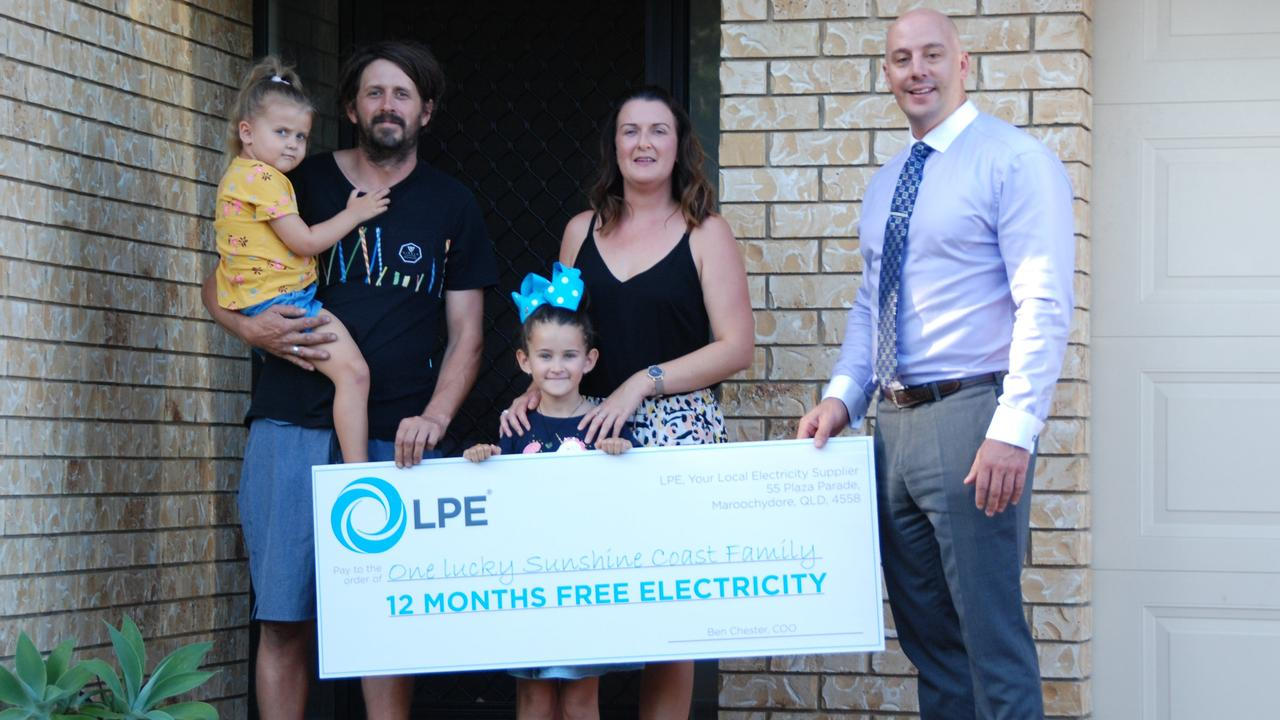 Former LPE business partner Ben Chester hands over a check for 12-months free electricity to the McKay Family.