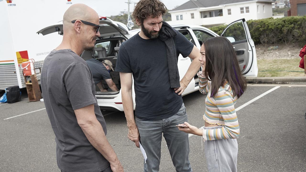 Writer and star Scott Ryan and director Nash Edgerton, with Edgerton's daughter Chika Yasumura on the set of Mr Inbetween Season 3.