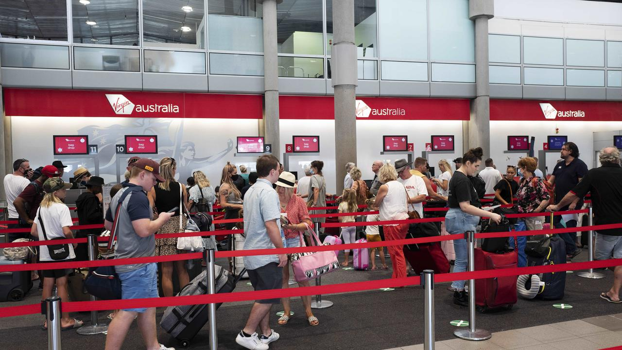 A packed check-in at Virgin Australia at Brisbane Domestic Airport, Brisbane, but when will this scene be repeated in the international terminal? (News Corp/Attila Csaszar)