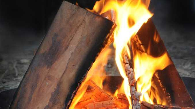Woman, child dragged to fire in terrifying campsite rampage