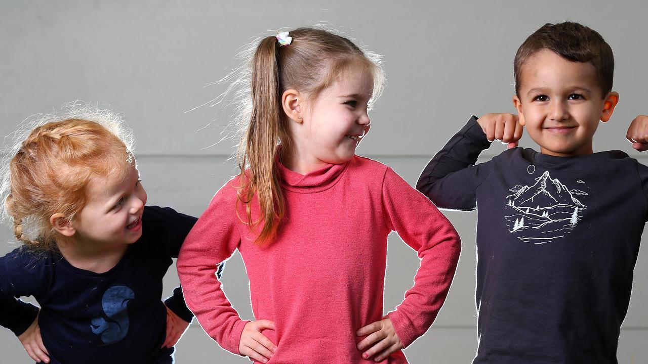 Zoe Moran, Mia Thomson and Ryan Saleh, all 3, are happy, confident children. Picture: Adam Head