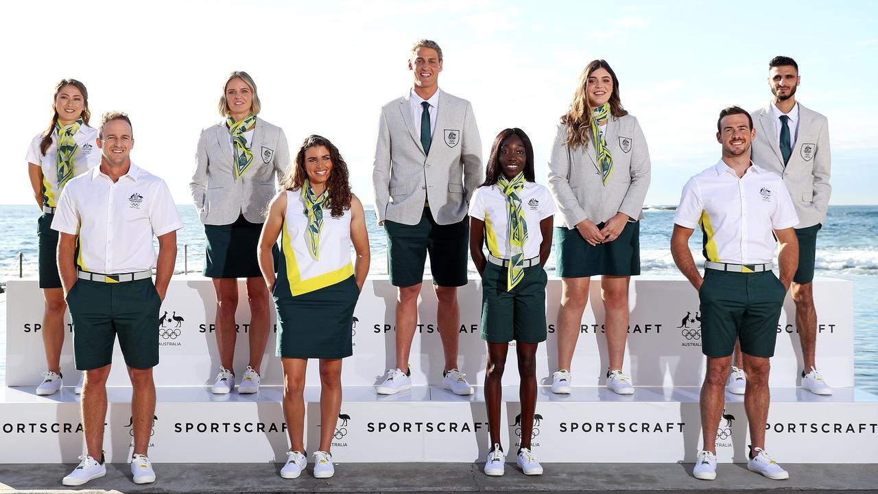 Pictured are Olympic Athletes (from left) Gronya Somerville, Lachlan Tame, Keesja Gofers, Jess Fox, George Ford, Bendere Oboya, Tarni Stepto, Dan Watkins and Safwan Khalil, unveiling the Sportscraft Tokyo Olympic Games Uniforms at Wylies Baths in Coogee today. Picture: Tim Hunter.