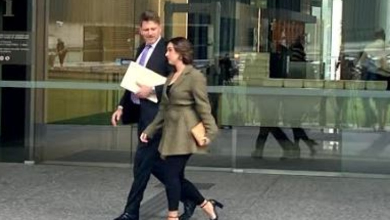 The sister of Christian Dino Lawlor, who is charged with the manslaughter of his mother, leaving court with his solicitor, Nick Dore. Picture: Cormac Pearson