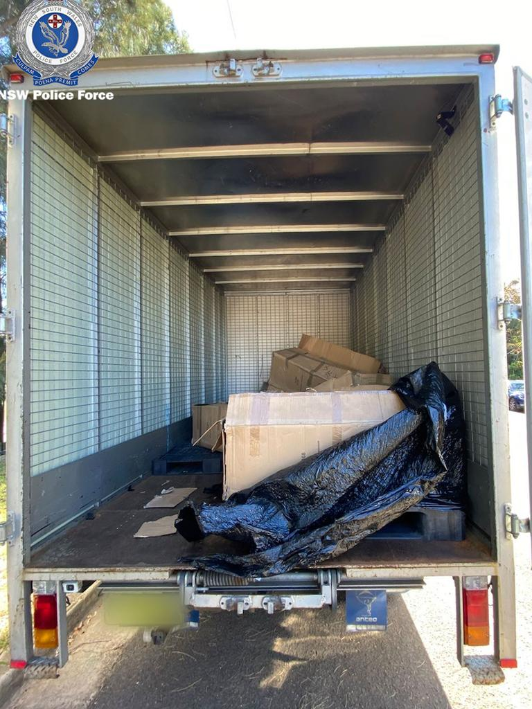 During a search of the truck, police allege they found 514kg of compacted white powder concealed within steel boxes