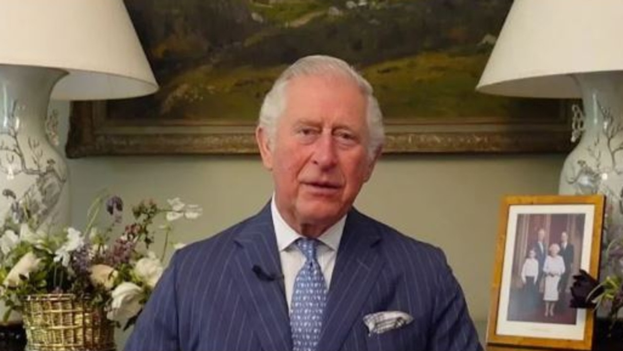 Prince Charles spoke to an Australian conference via video where a photo of Prince William, the Queen and Prince George can be seen in the background. Picture: Supplied