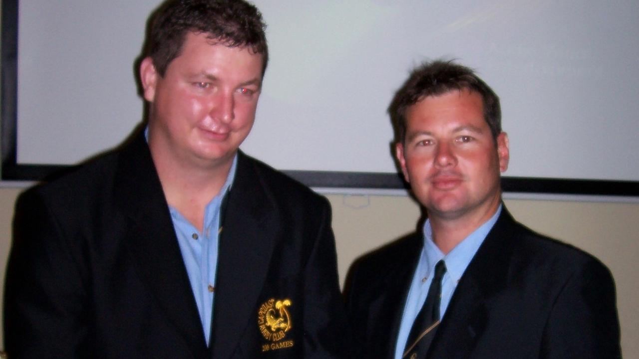 Brett Shackleton (left) receiving his 200-game blazer in 2005 from Matthew Duckwitz, Crocs former player and life member.