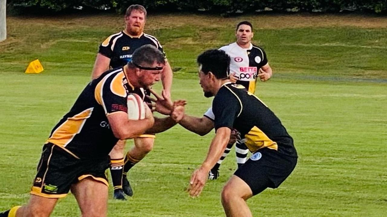 Second rower Brett Shackleton (left) charges into action in his 400th game for the Cap Coast Crocs.
