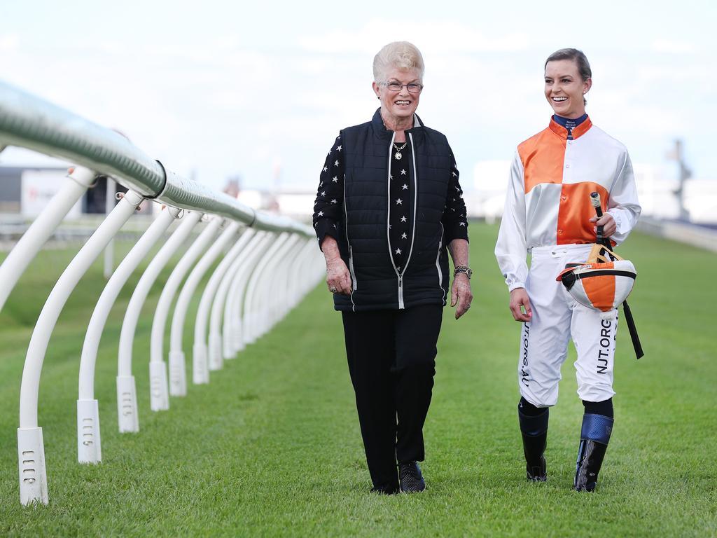 Pam O'Neill walks the Doomben track with apprentice Wendy Peel. Picture: Tara Croser