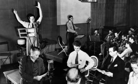 Photograph of a rehearsal of CBS Radio's The Mercury Theatre on the Air, printed in many US newspapers following the broadcast of