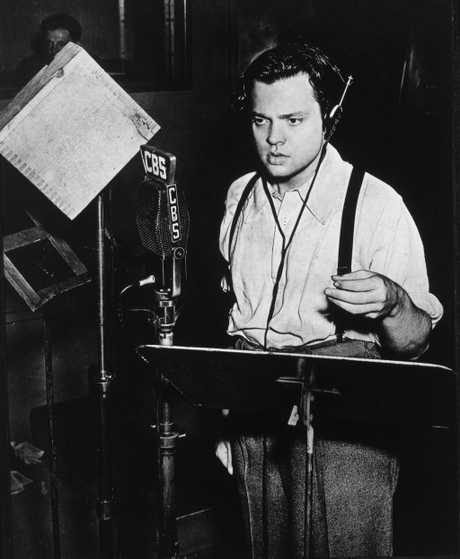 Orson Welles at work in the CBS Radio studio. Photo care of Dallas Dispatch-Journal, October 31, 1938.