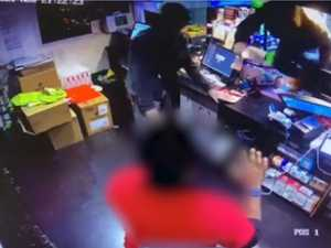 WATCH: Dramatic moment armed robbers storm servo