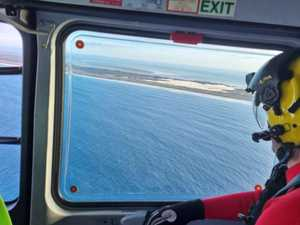 Hope fades for surf skier as aerial search cancelled