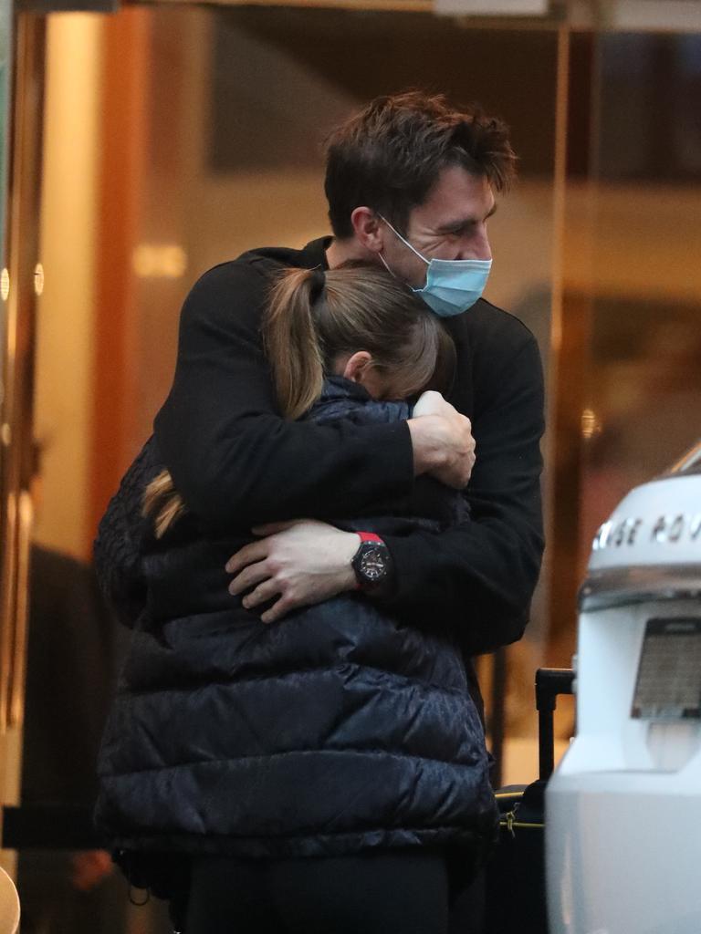 Pat Cummins embraces his pregnant partner Becky Boston. Picture: John Grainger