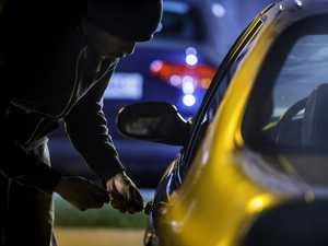 Gutless car thief runs when confronted, then attacks woman