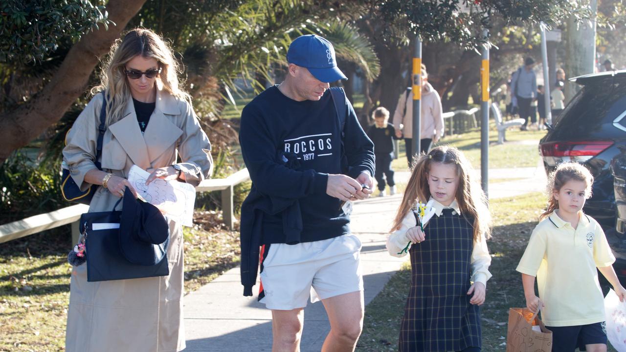 Candice Warner and David Warner doing school pick-up this week after David left hotel quarantine. Picture: Matrix Media