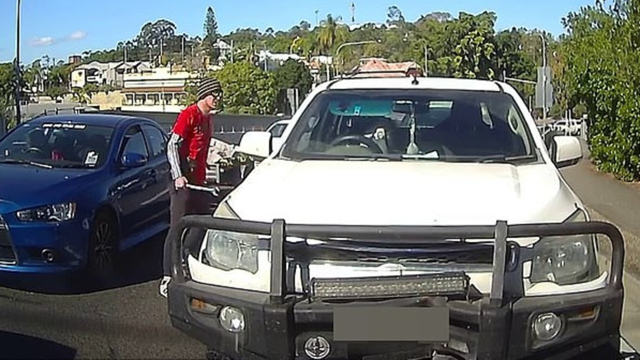 Dash cam footage captures the moment a man uses a spanner to attack another vehicle at Sadliers Crossing. Picture: Dash Cams Australia