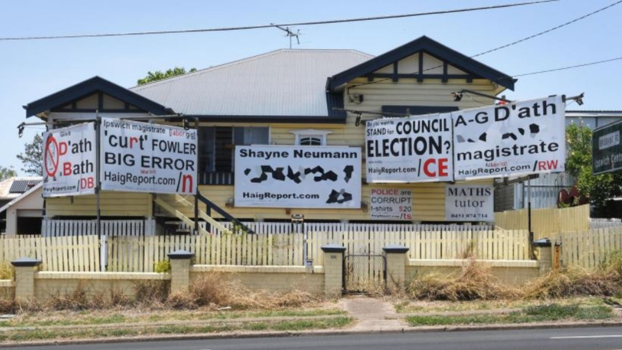 Political signs formerly erected in front of the home of Russell Gordon Haig Mathews, who is appealing a $30,000 fine.