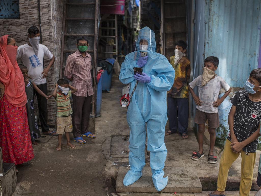 Muhammad Yunus, 32, in PPE, co-ordinator for the Covid-19 awareness program in Mumbai, India. Picture: UNICEF