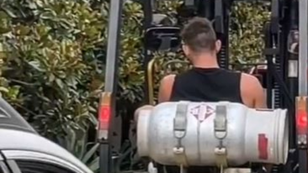 The man was filmed patiently waiting in line at Hungry Jack's on-board a forklift.