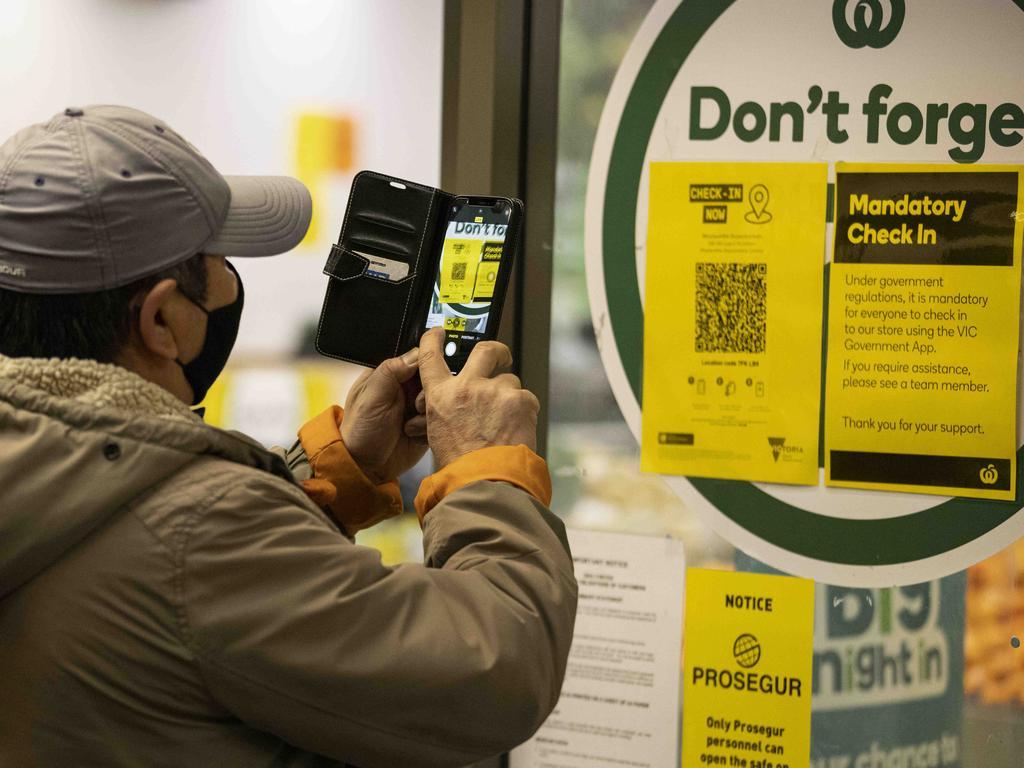 A person scans a QR code before entering a supermarket in Victoria. Picture: NCA NewsWire/Daniel Pockett
