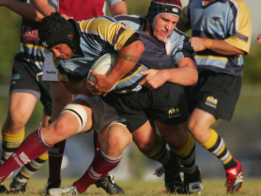 Shane Tehuia (with ball) on the charge in a match between Stingrays and University. Photo: Brett Wortman