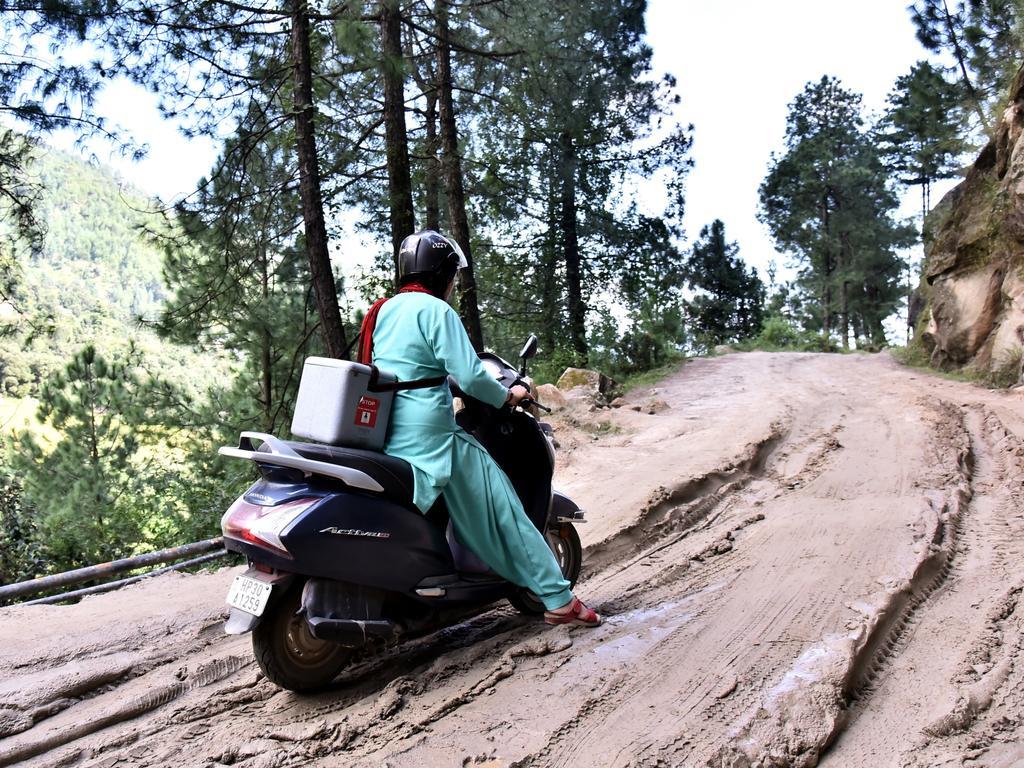 A health worker travelling on motorbike in the hard to reach village Shankar Dehra, Tehsil Thunag, District Mandi, Himachal Pradesh, India. Picture: UNICEF India/Ashutosh Sharma
