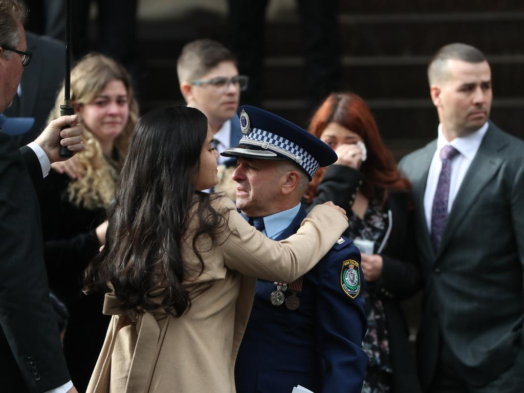 Aaron Vidal's fiancee Jessica Loh and father Chief Inspector David Vidal embrace at the constable's funeral at St Mary's Cathedral. Picture: Rohan Kelly