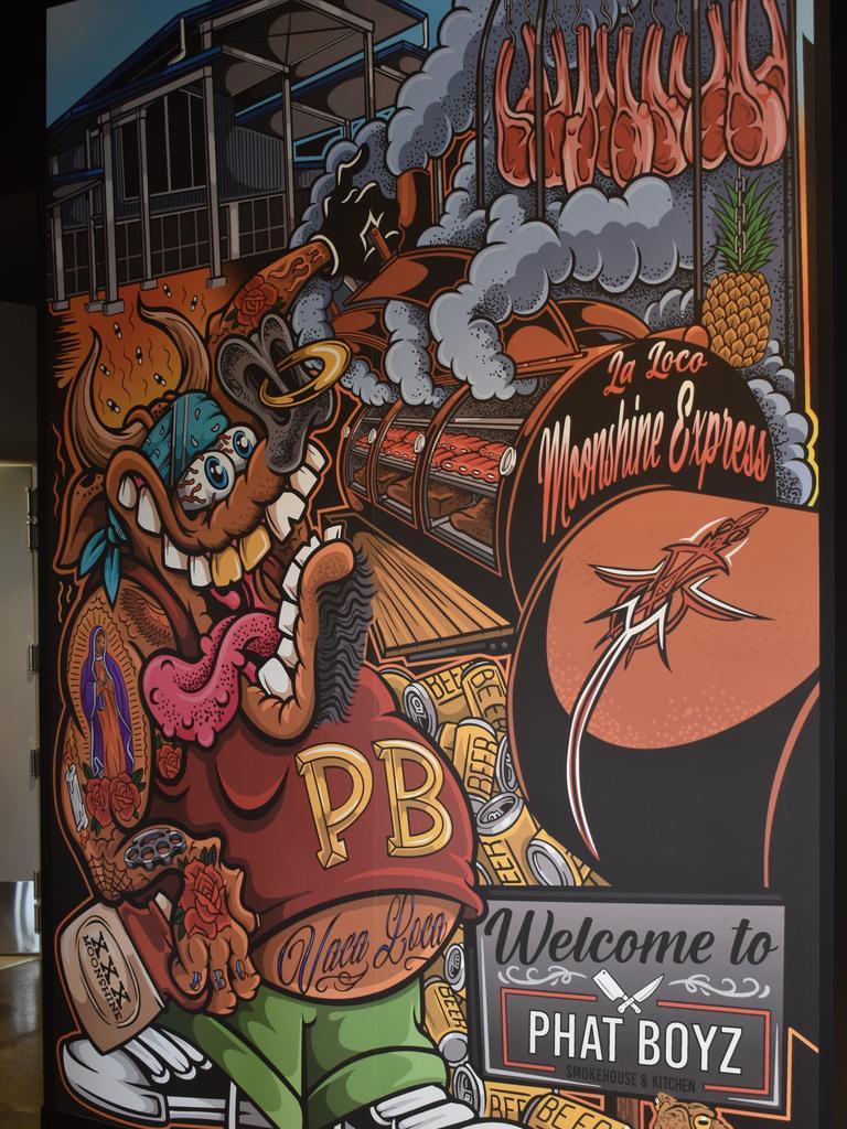 Mural by graffiti artist and tattooist Micky Hora inside Phat Boyz Smokehouse and Kitchen.
