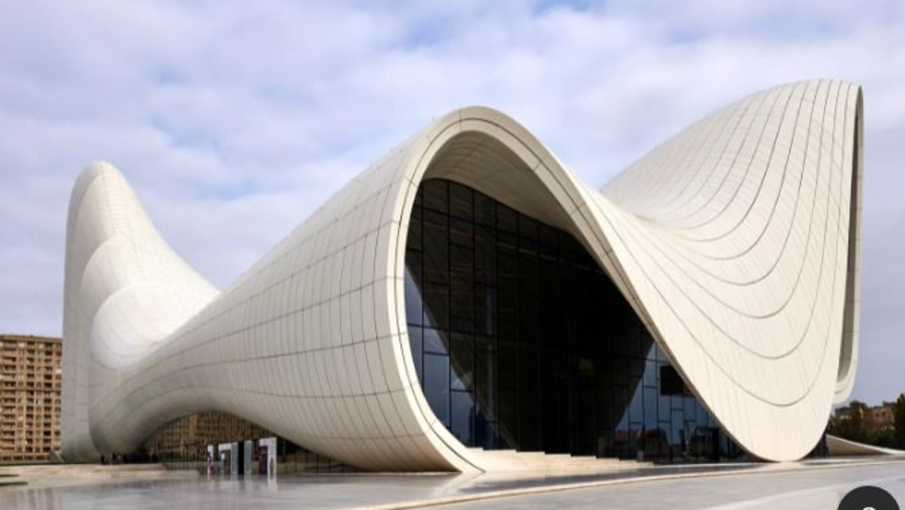 Clad in reinforced concrete and polyester, the 619,000-square-foot Heydar Aliyev Centre in Baku, Azerbaijan, is known for its swooping façade. Architect: Zaha Hadid