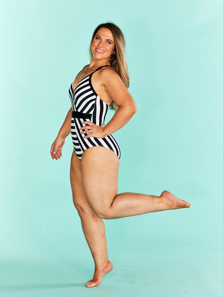 Cassie posing in a one-piece swimming costume for a Healthy Mummy photo shoot. Picture: Supplied