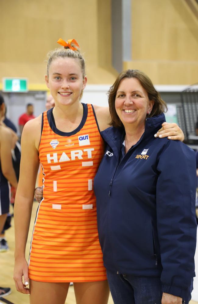 QUT netball rising star Reilley Batcheldor (left) and coach Paula Stuart.