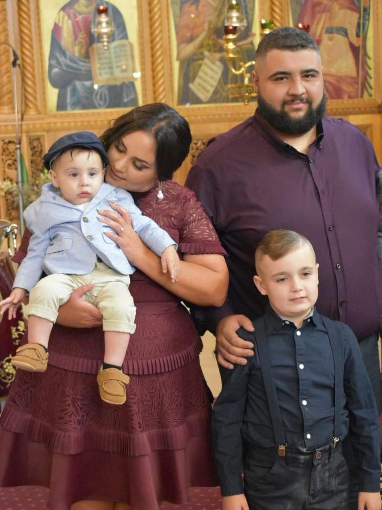 Elizabeth Kakias holding Alexander, before he got sick, husband Nicholas and older son Romeo.