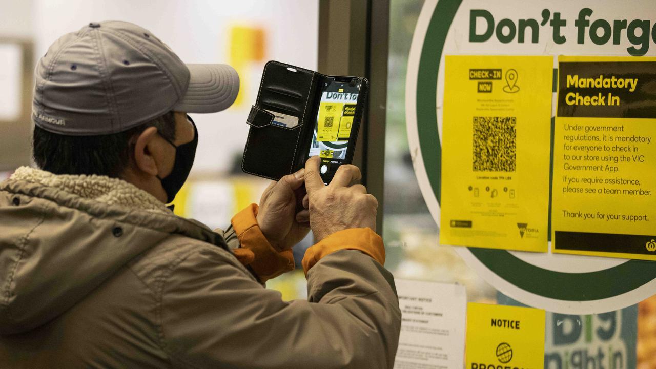 A person scans a QR code before entering a supermarket in Carlton, Melbourne. Picture: NCA NewsWire/Daniel Pockett