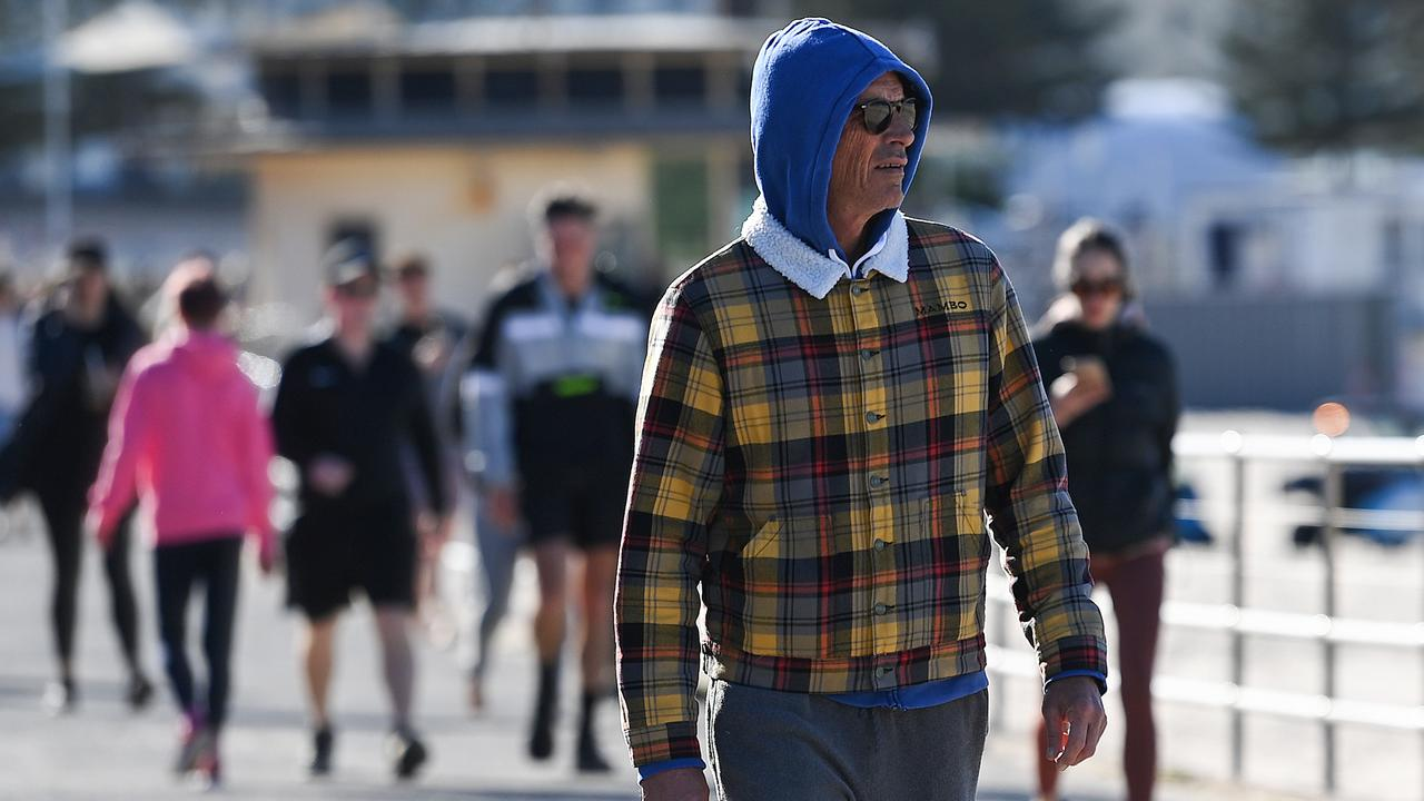 Rugged up Sydneysiders as they walk along Bondi Beach on Sunday morning. Picture: NCA NewsWire/Bianca De Marchi