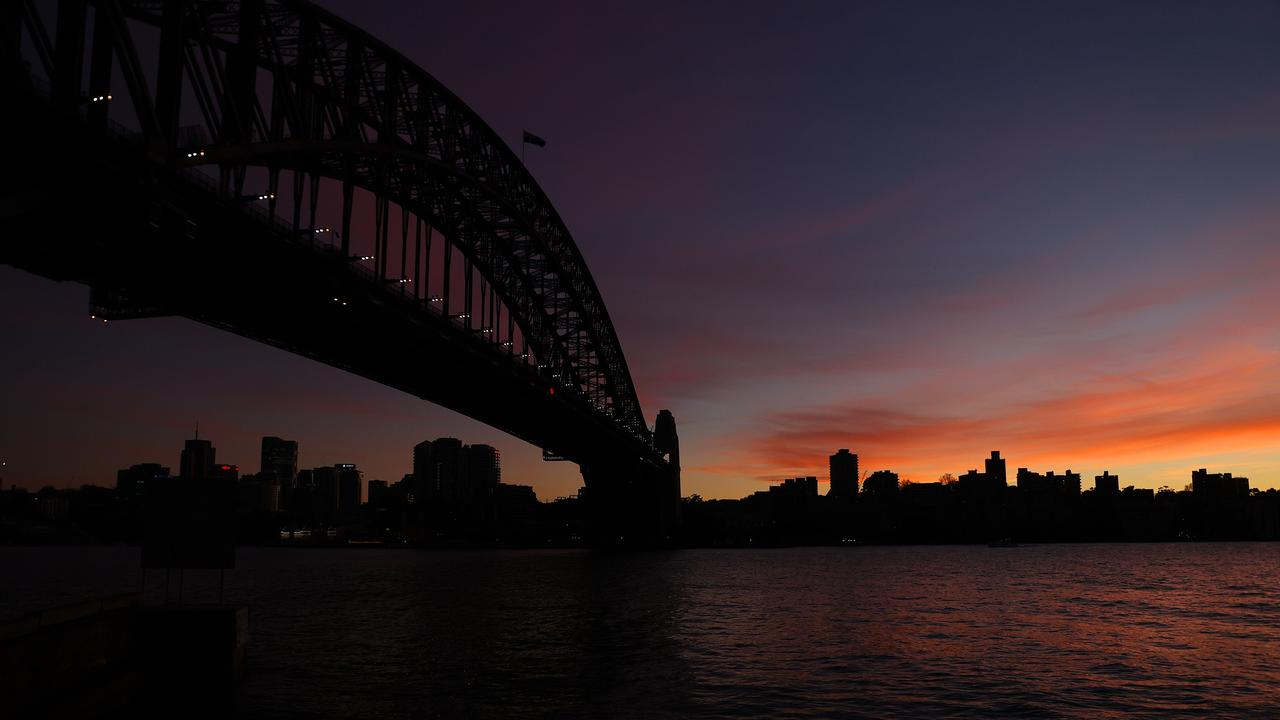 The sun rises over Sydney Harbour on a chilly Monday morning. Picture: NCA NewsWire / Dylan Coker