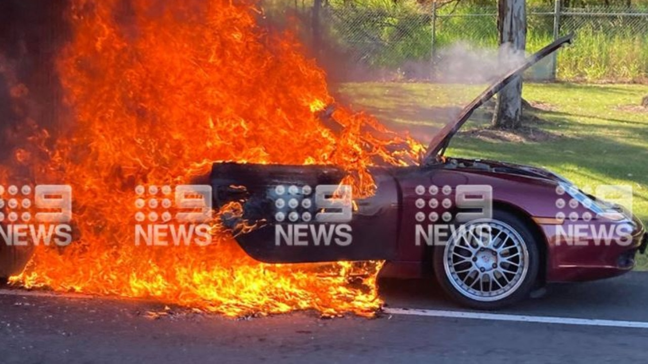 The Porsche was engulfed in flames on the Gold Coast on Monday morning.