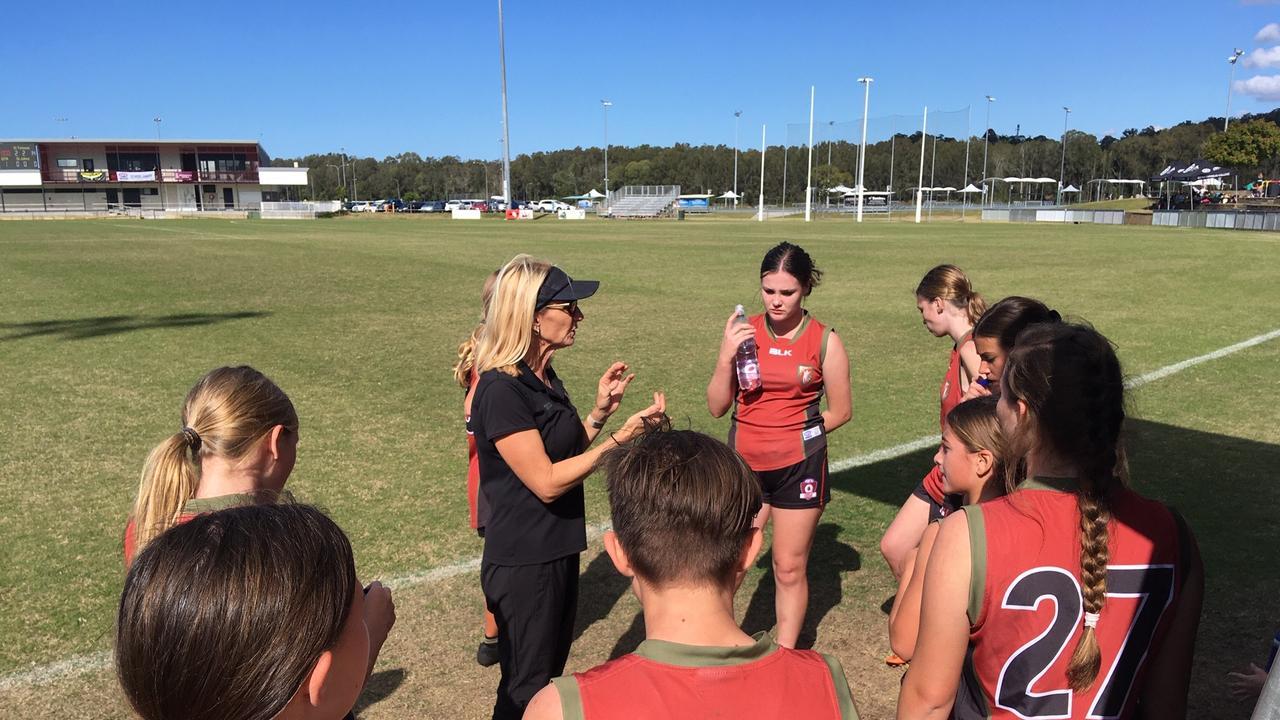 St Teresa's Catholic College coach addresses her team in the quarter final