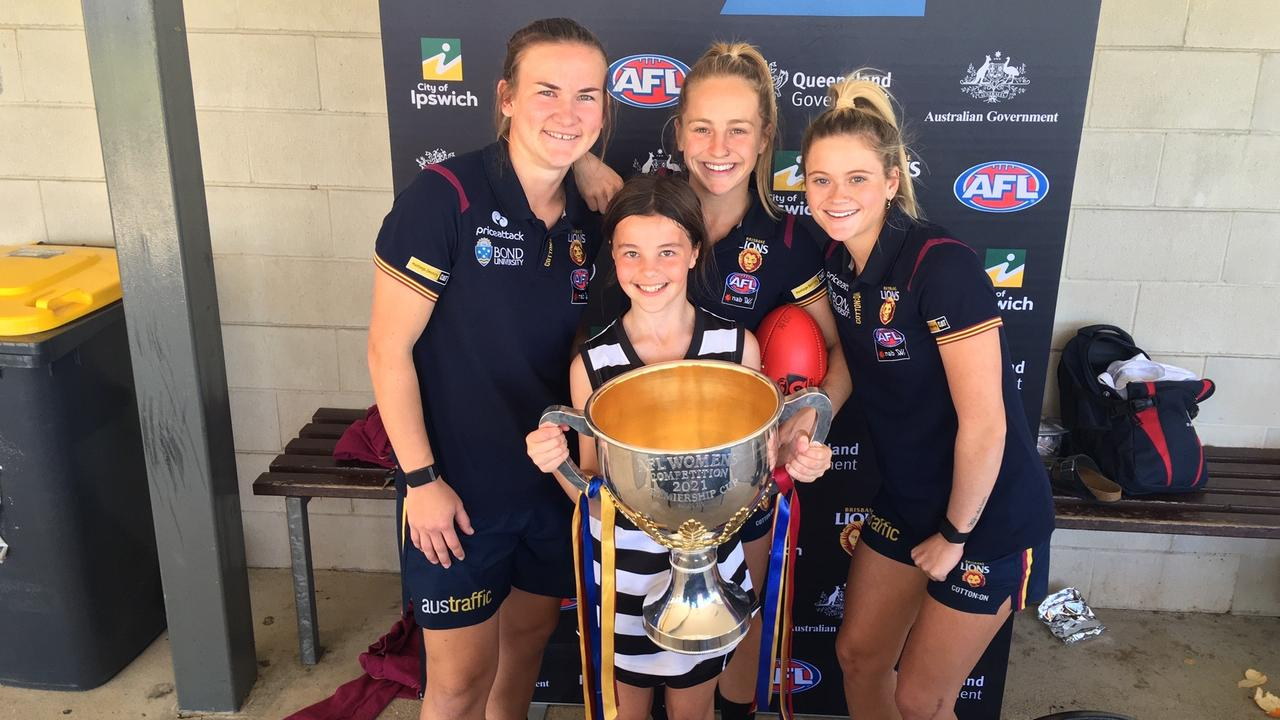 Sunshine Coast juniors from the Premiership winning Brisbane Lions AFLW side, Belle Dawes, Lily Postlethwaite and Shannon Campbell visited the Schools Footy day to display the Cup.