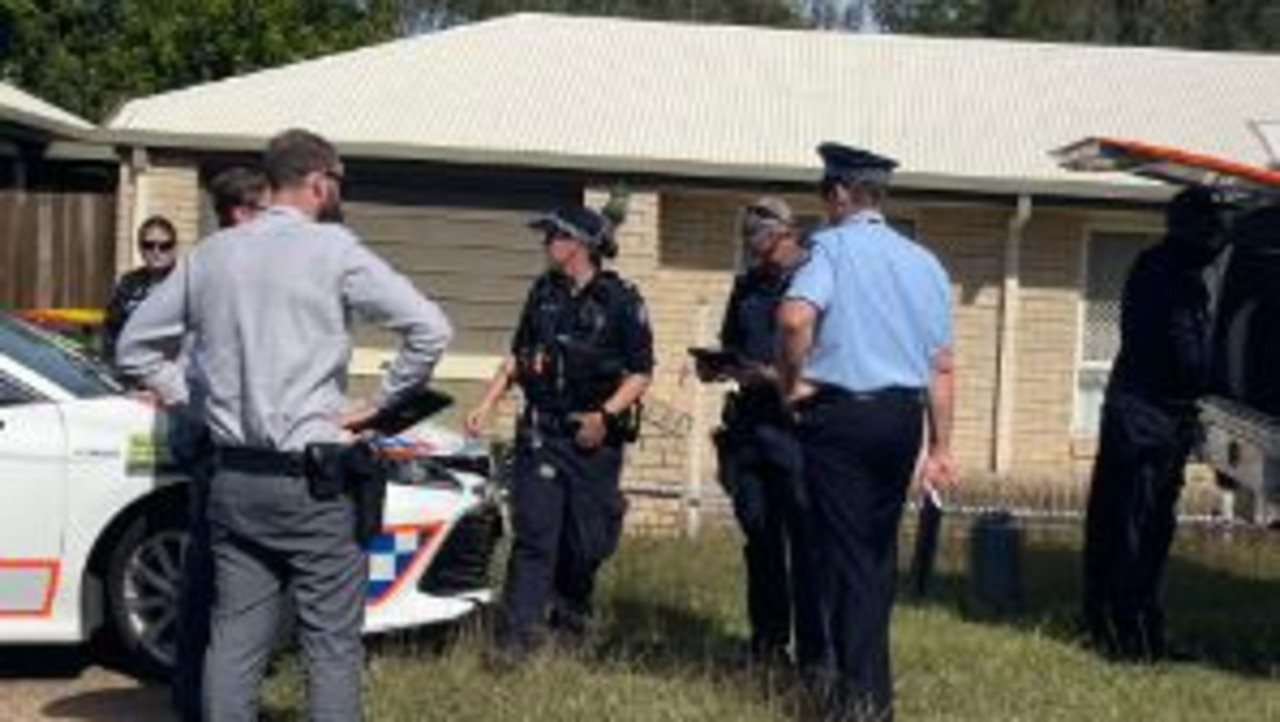 Police guarding the scene of a fatal dog attack at Milton Street, Maryborough.
