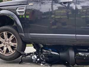 Motorbike wedged under 4WD as crash stops busy Coast road