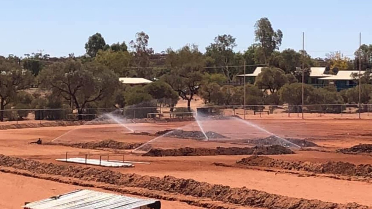 Resurfacing the oval with grass in Central Australia was always going to be a challenge. Picture: Supplied