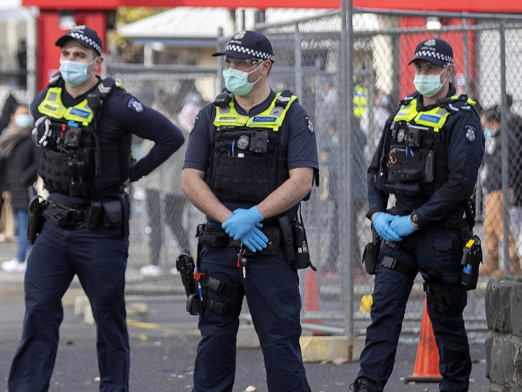 Police on the lookout for protesters at the Sandown Racecourse vaccination centre. Picture: NCA NewsWire/David Geraghty