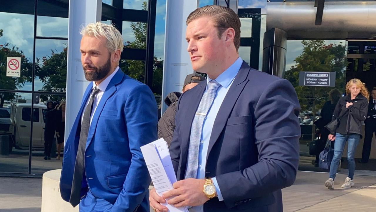 Troy Kenneth Williams, known as 'Candyman 2.0', outside court in Southport with defence lawyer Blake Fraser of Fraser Lawyers. Picture: Lea Emery.