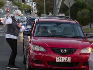 Tensions high as exposed residents rush to Covid test site