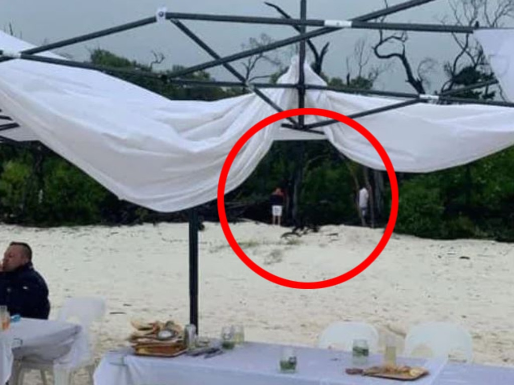 A marquee appears damaged by rain and 'extreme' winds and men can be seen going to the toilet in the view of diners.