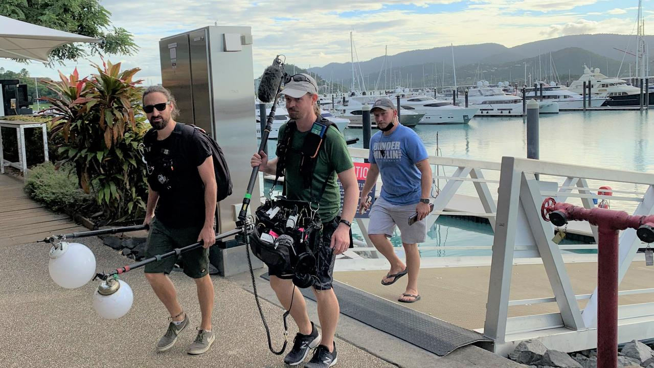 The film crew were tight-lipped about the goings on aboard the superyacht Thalassa at Coral Sea Marina on Tuesday, but witnesses said they appeared to be making a reality TV show.