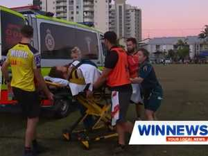 Rugby player stretchered off after nasty clash